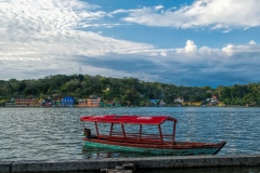 Sunrise on a boat taxi driver in Flores, Guatemala   Image By Indiana Architectural Photographer Jason Humbracht